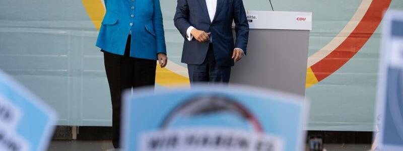 Wahlkampf CDU - Merkel und Laschet - Foto: Federico Gambarini/dpa